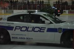 Aiden riding police car at fundraiser