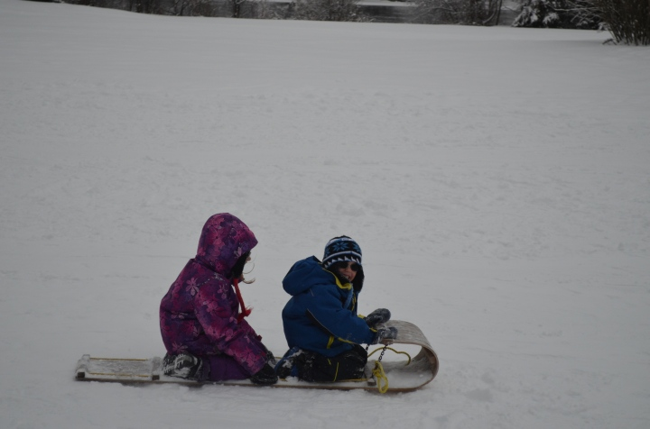 Abby & Aiden going by on their toboggan