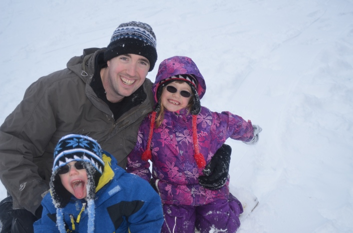 Aiden, Abby & Dad after a long afternoon of sledding