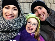 Melissa, Peter and Abby at outdoor practice waiting for Aiden
