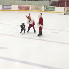 Playing Santa and his elf