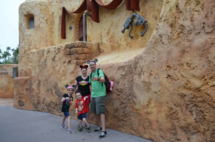 The family with their make believe lightsabers in Tatooine.