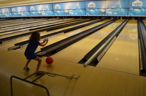 Abby bowling the ball on her own