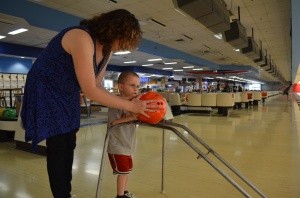 Melissa helping Aiden bowl