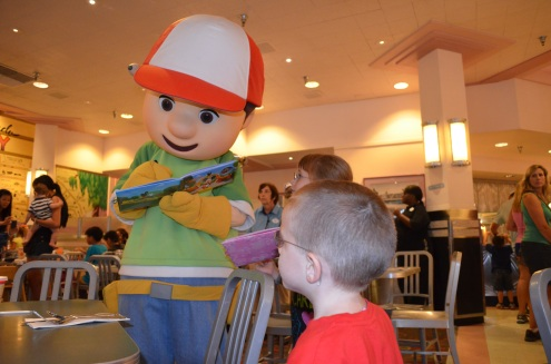 Handy Manny signing Aiden and Abby's autograph book