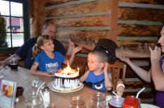Aiden wearing the moose hat while cake catches on fire :)