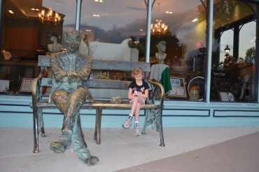 Abby copying the statue on the bench