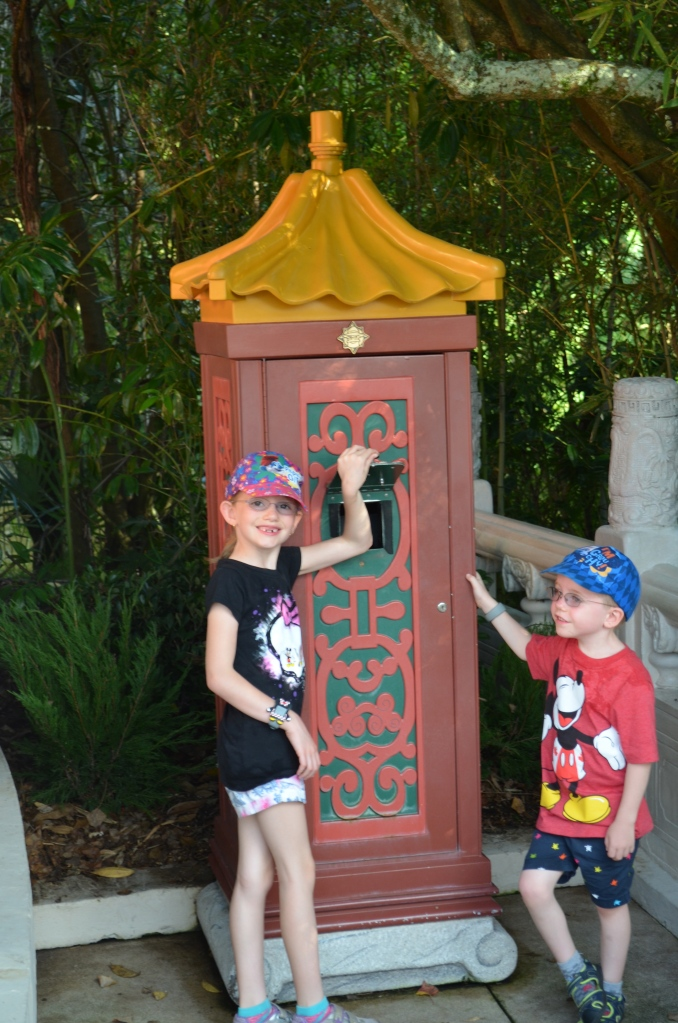 The kids checking out what they think is a mailbox