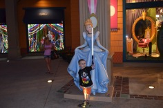 Aiden with his new light sabre outside Disney Store