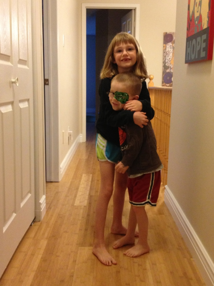 Abby hugging Aiden on the morning of her birthday