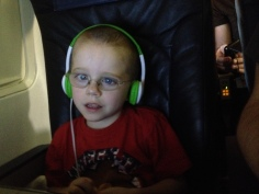 Aiden watching a video on the plane