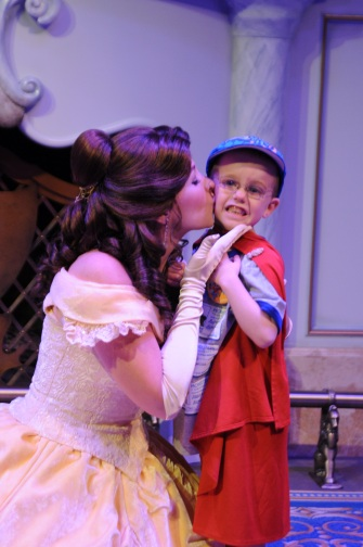 Princess Belle kissing Aiden as he played The Beast