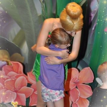 Abby hugging Tinker Bell
