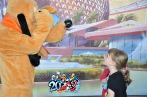 Pluto signing the kids autograph book