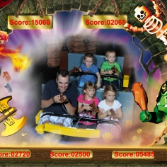 Peter with Abby and Ava in Front and Aiden and Willy in back on ride at Legoland