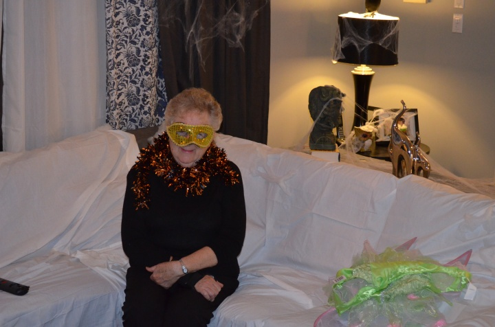Mama dressed up waiting for Trick or Treaters