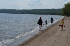 Melissa, Abby, Aiden and Genny walking along the shore in Lake Temiskaming.