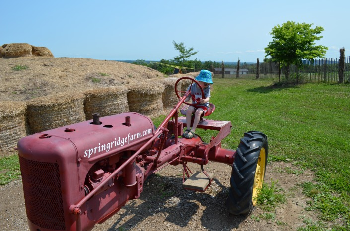 Aiden checking out the tractor