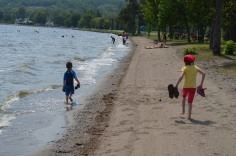 Aiden and Abby running along the shore of Lake Temiskaming.