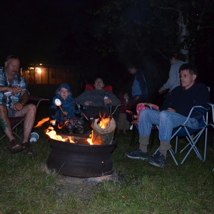 Sitting around the campfire roasting marshmallows on Fri evening