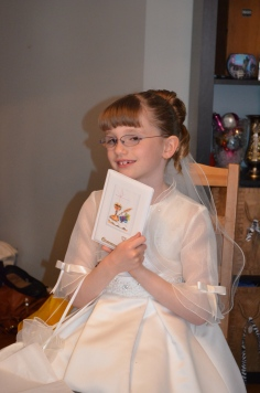 Abby holding one her cards.