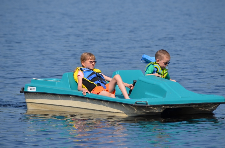 Abby and Aiden paddle boating