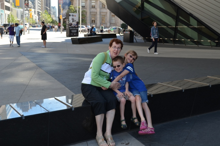 Grandma with Abby and Aiden in front of the ROM