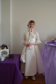 Abby holding her baptism candle