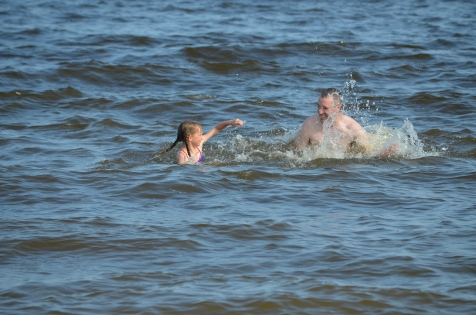 Abby and Dad splashing each other in Lake Temiskaming.
