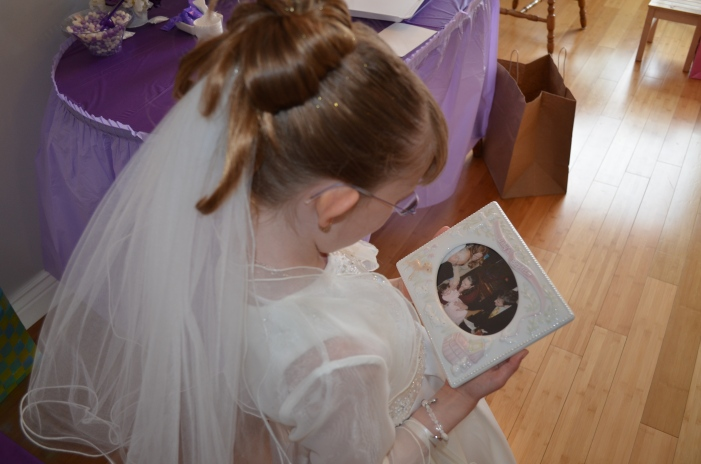Abby looking at her baptism picture