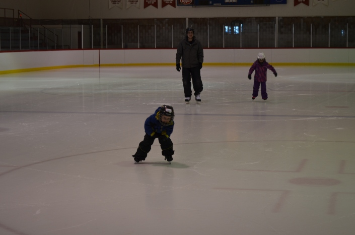 Abby and Aiden with Daddy skating at the Warsaw Arena