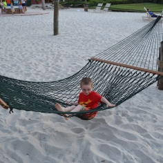 Aiden trying to figure out a Hammock on the beach