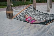 Abby swinging on a Hammock on the Beach