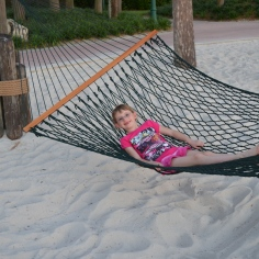Abby swinging on a Hammock on the Beach