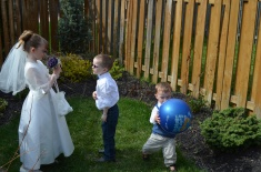 Abby, Aiden, and Macklan playing in the backyard