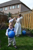 Macklan escaping with the ball while Abby and Aiden check out the camera.