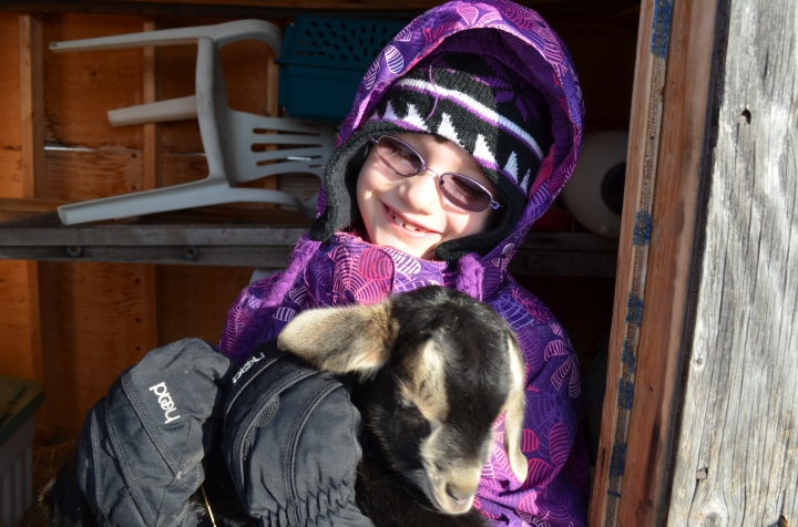 Abby holding a baby goat
