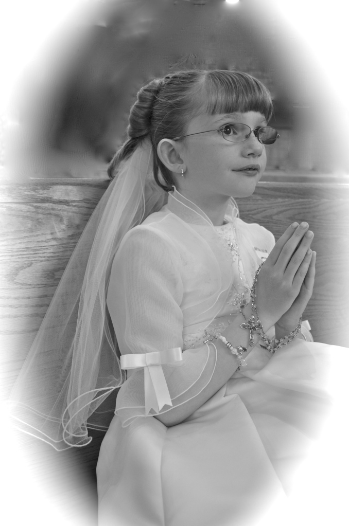 Abby in the church after her First Communion