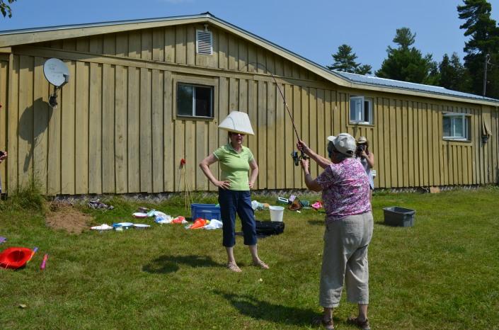 Joyce blindfold lampshade fishing with Jackie
