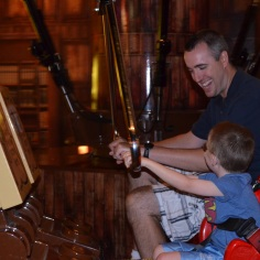 Peter laughing with Aiden on a ride