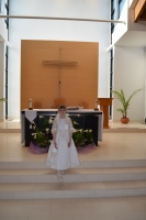 Abby in front of the altar at St. John
