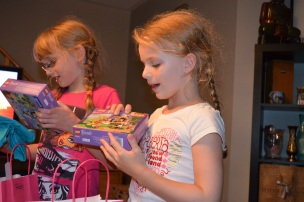 Abby and Ava opening their loot bags