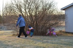 Mama helping Abby and Aiden on their Easter Egg Hunt