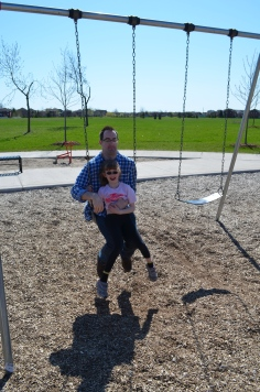 Abby with Uncle Rob on the swings
