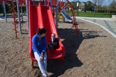 Aiden and Melissa having a conversation on the slide