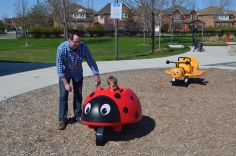 Uncle Rob helping Macklan on the Lady Bug