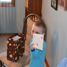 Aiden holding a card that he got from Mama