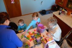 Abby, Aiden, Mom and Mama counting their loot.