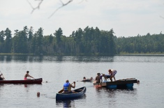 Aaron in the blue canoe. Shauna in the front of the other canoe. Lucas, Stephanie and Chad on the dock. Chantale in the water beside Aaron.