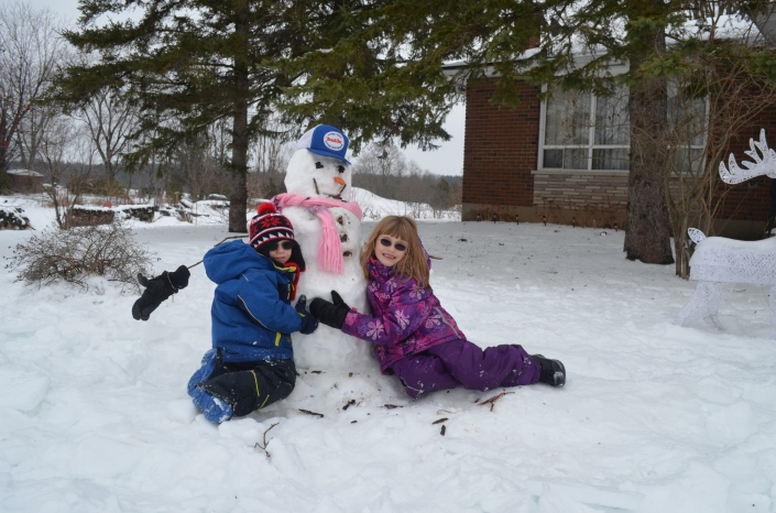 Abby and AIden with their Snowman at Mama and Papa's